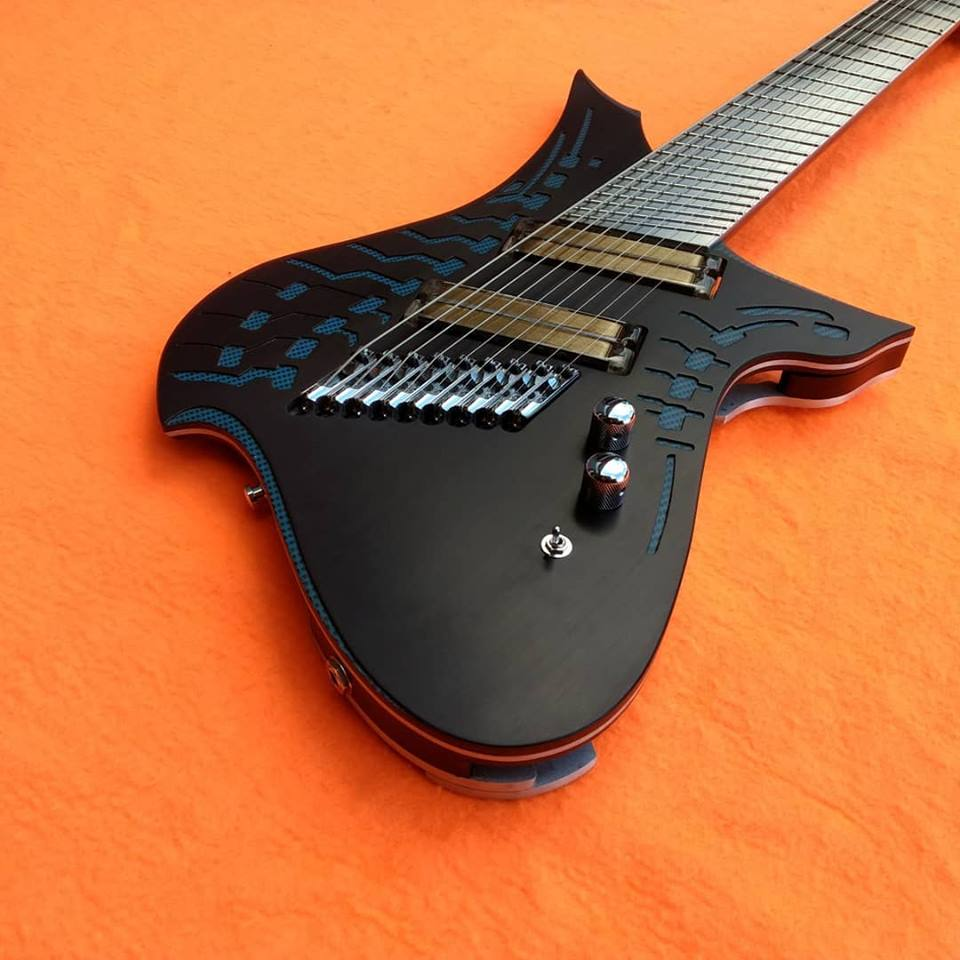 Etherial 9 string guitar equipped with silver q-tuner pickups