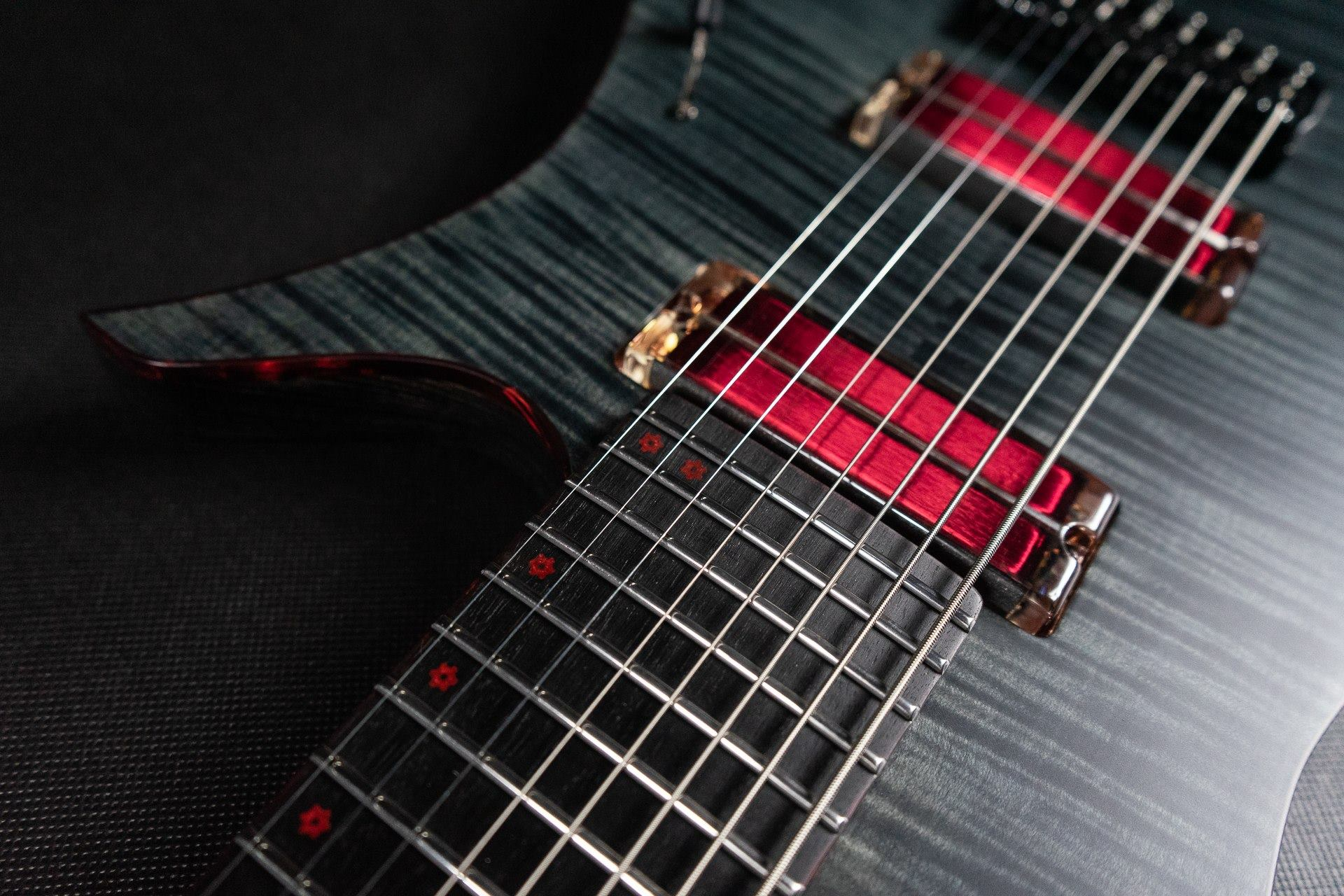 Beautiful Blackat guitar made by Tomek Sławiński with transparent neodymium q-tuners