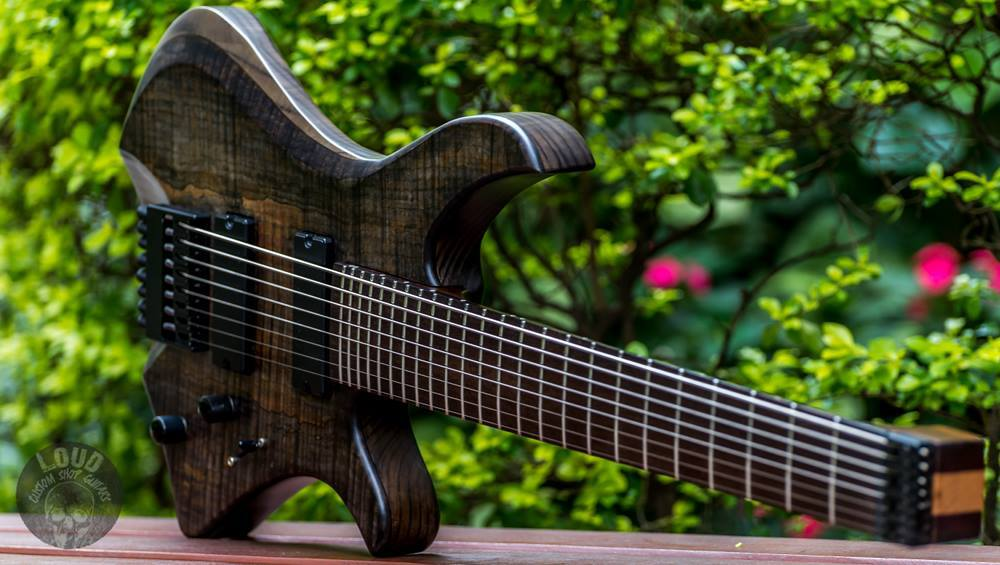 Beautiful eight string guitar from Brazil equipped with Q-tuner q2 stealth pickups.